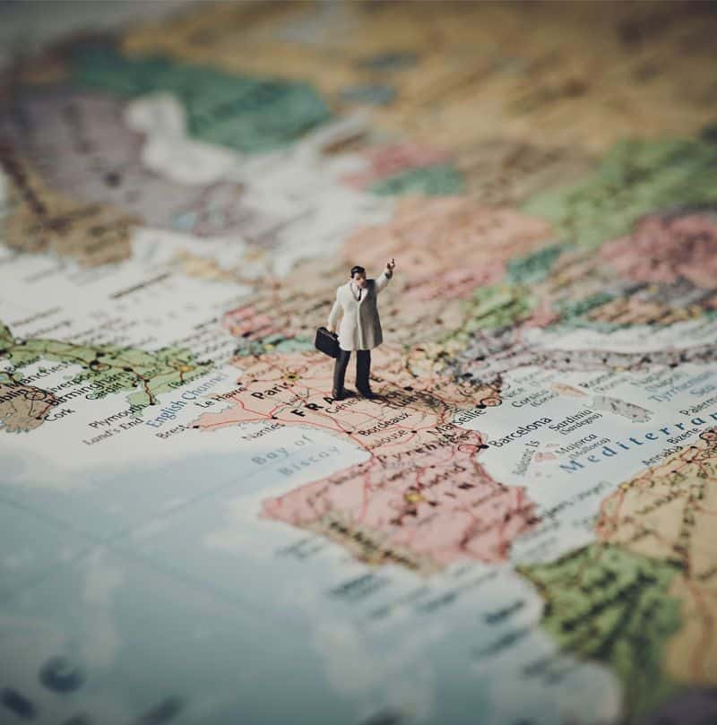 an image to show a plastic figure on top of a map to illustrate international services
