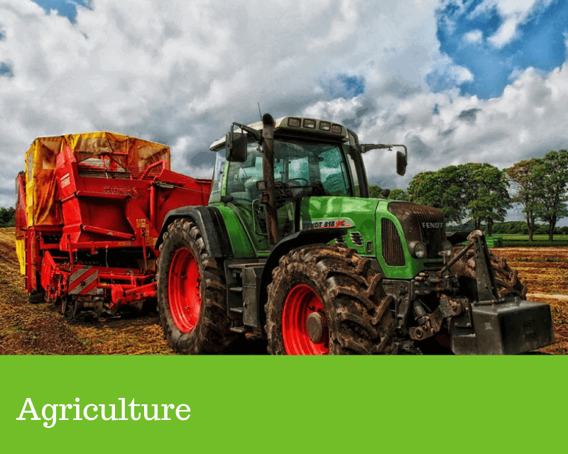 tractor in a field to show the agriculture sector